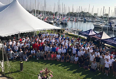 competitors gather for a group shot while waiting for wind