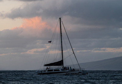 Sailboat Under Cloudy Skies