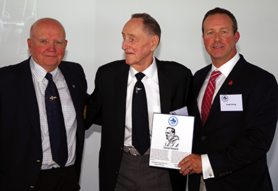 Paul Henderson inducts David Howard; Todd Irving, Sail Canada President presents plaque