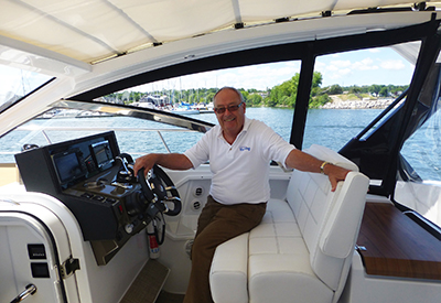 Cruisers Yachts 390 Express Coupe with John Armstrong at the helm